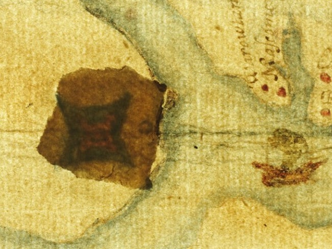 """A """"fort-like image"""" is visible on the map behind a paper patch after it is backlit. Picture: British Museum"""