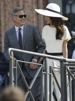 George Clooney and Amal Alamuddin leave Venice's city hall, Italy on Monday, September 29th 2014. Picture: AP