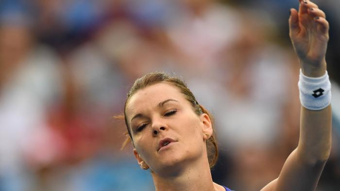 Agnieszka Radwanska of Poland in action against Mirjana Lucic-Baroni of Croatia during the Womens Singles match in round 2 on day four of the Australian Open in Melbourne, Thursday, Jan. 19, 2017. (AAP Image/Tracey Nearmy) NO ARCHIVING, EDITORIAL USE ONLY