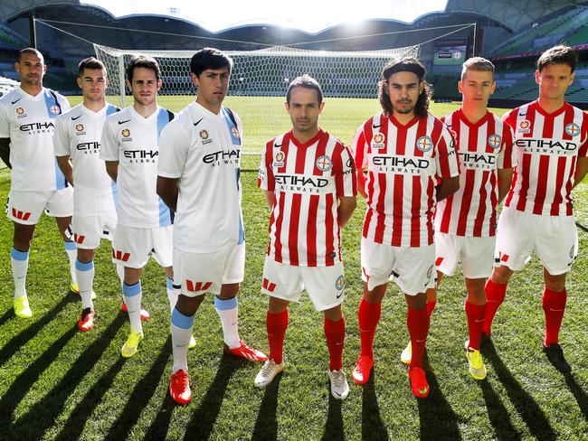 Melbourne City's uniform unveiled at AAMI Park on Monday. Patrick Kisnorbo, Ben Garuccio, Mate Dugandzic and Jonatan Germano wear the new white home strip and Massimo Murdocca, David Williams, Stefan Mauk and Rob Wielaert wear the new red and white away strip. Picture: Michael Klein