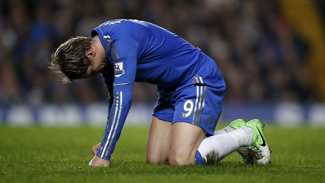 Chelsea's Fernando Torres gets up off the grass after a challenge during the English League Cup semi-final at Stamford Bridge. Picture: Matt Dunham