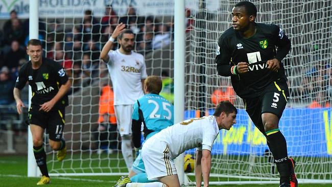Norwich City's French-born Cameroonian defender Sebastien Bassong celebrates after slotting one into the back of the net against Swansea City.