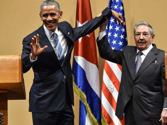 Cuban President Raul Castro (R) raises US President Barack Obama's hand during a meeting at the Revolution Palace in Havana on March 21, 2016. Picture: AFP