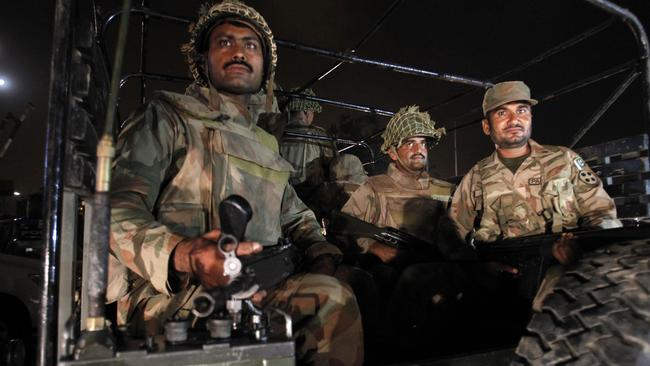 Reinforcements ... troops arrive at Karachi airport after the terror attack.