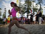 Prince William and Catherine, the Duchess of Cambridge watch a beach sprint race at Manly Beach