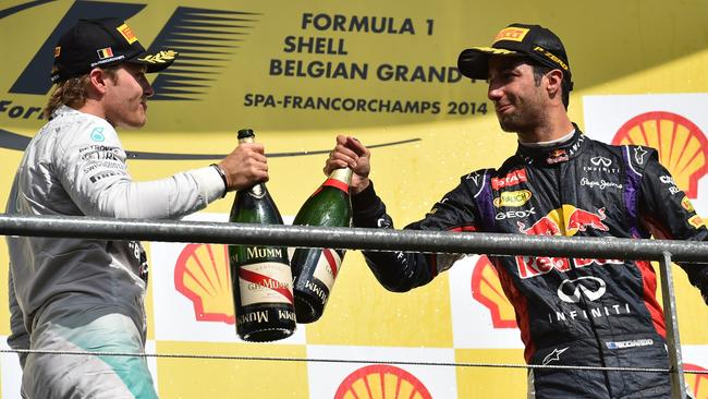 Cheers for that, Nico: Daniel Ricciardo on the podium with Rosberg after winning in Belgium.