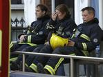 Firefighters wait to start their shift during the massive operation to fight the fire in the 27-storey high-rise apartment building. Picture: AP/Matt Dunham