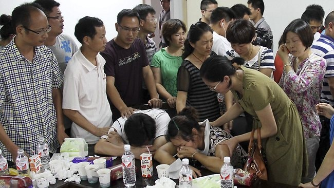 The parents of Flight 214 victim, Wang Linjia, are comforted by parents of some other students who were on the Asiana Airlines jet that crashed at San Francisco International Airport. Ye Mengyuan and Wang Linjia, students at Jiangshan Middle School in China's eastern Zhejiang province, were both killed.