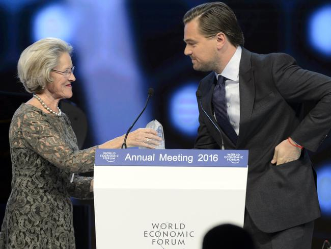 Top honours ... US actor Leonardo DiCaprio receives a Crystal Award from German Hilde Schwab, chair and co-founder of the Schwab Foundation for Social Entrepreneurship. Picture: Jean-Christophe Bott/Keystone via AP