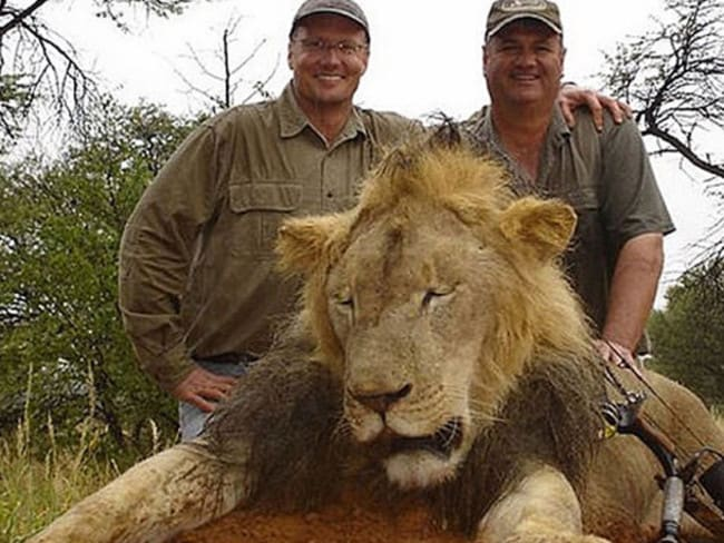 Avid hunter ... Walter Palmer (left) with one of his previous trophies. Photo: Cacebook.