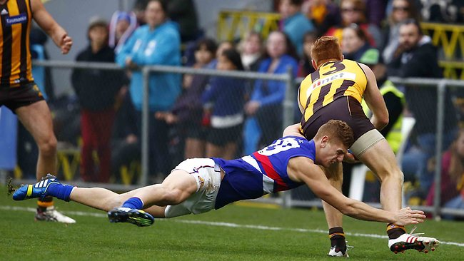 Liam Jones tries to tackle Kyle Cheney during the 2nd quarter of the Hawthorn vs Western Bulldogs match at Aurora Stadium, Launceston. Saturday July 20, 2013. Picture: Klein Michael