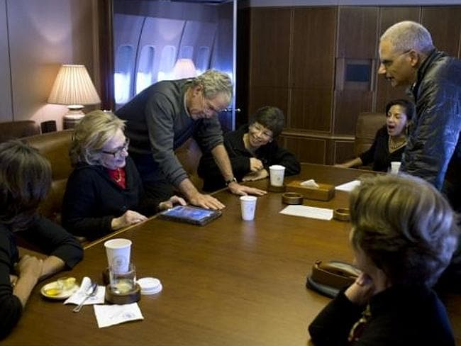 Former US President George Bush shows off his art to the group. Picture: Pete Souza / Official White House Photo
