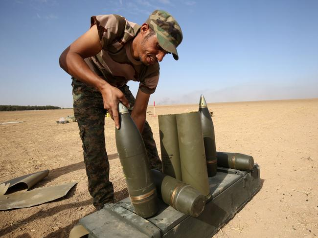 Shiite fighters from the Hashed al-Shaabi (Popular Mobilisation) prepare missiles to hit Islamic State positions. Picture: AFP/Ahmad Al-Rubaye