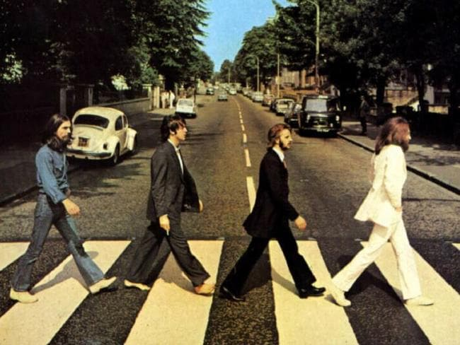 Another road ... The Beatles as seen on their Abbey Road album cover George Harrison, Paul McCartney, Ringo Starr and John Lennon.