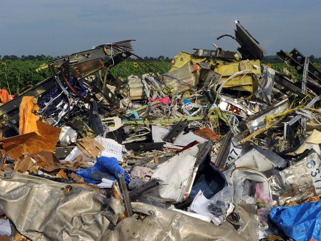 Passenger's belongings are strewn throughout the wreckage.