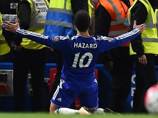 Chelsea's Belgian midfielder Eden Hazard celebrates scoring their second goal to level the score at 2-2 during the English Premier League football match between Chelsea and Tottenham Hotspur at Stamford Bridge in London on May 2, 2016. / AFP PHOTO / BEN STANSALL / RESTRICTED TO EDITORIAL USE. No use with unauthorized audio, video, data, fixture lists, club/league logos or 'live' services. Online in-match use limited to 75 images, no video emulation. No use in betting, games or single club/league/player publications. /