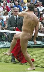 <p>Tournament referee Alan Mills attempting to catch an naked male streaker during mens singles final match at Wimbledon Championships 07 Jul 2002.</p>