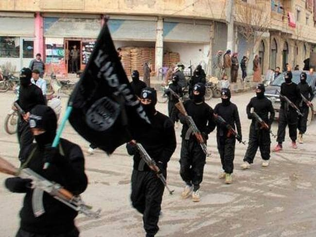 'No 1 enemy' ... fighters from the al-Qaida linked Islamic State marching in Raqqa, Syria. Picture: AP