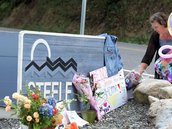 Karole Johnson places balloons of princesses and flowers at the entrance sign to the Steele Creek Mobile Home Park on Thursday, the day Jenise Wright's body was found.