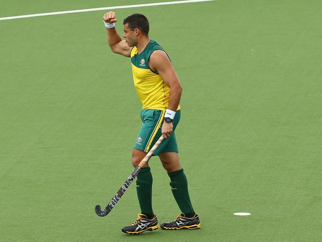 Australia's Chris Ciriello celebrates scoring a penalty shot and helping rescue the Kookaburras from a possible upset by India.
