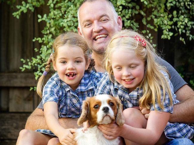 Rohan Hawker with daughters, Alanna and Caitlin at their home in Moonee Ponds.