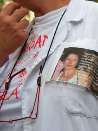 A protester takes part in a demonstration in support of Spanish nurse Teresa Romero infected with Ebola. Picture: AFP