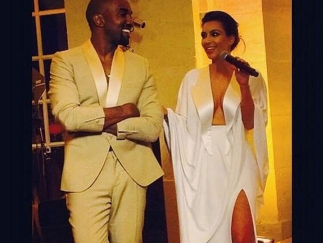 Kim and Kanye on their wedding rehearsal night.