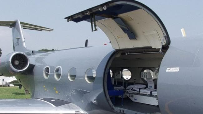 Special device ... the isolation pod is loaded onto a government-owned jet. Picture: US Centres for Disease Control.