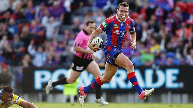 Darius Boyd races away to score for the Knights. Picture: Brett Costello