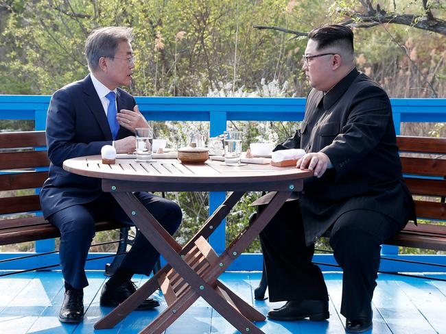 North Korean leader Kim Jong Un, right, and South Korean President Moon Jae-in talk at the border village of Panmunjom in the Demilitarized Zone, South Korea. Picture: AP