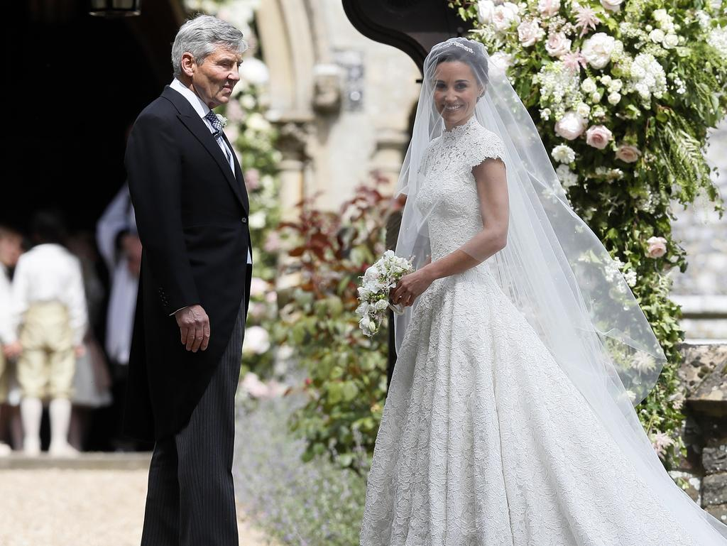 Pippa Middleton arrives with her father Michael Middleton for her wedding to James Matthews at St Mark's Church in Englefield, England Saturday, May 20, 2017. Picture:AP Photo/Kirsty Wigglesworth