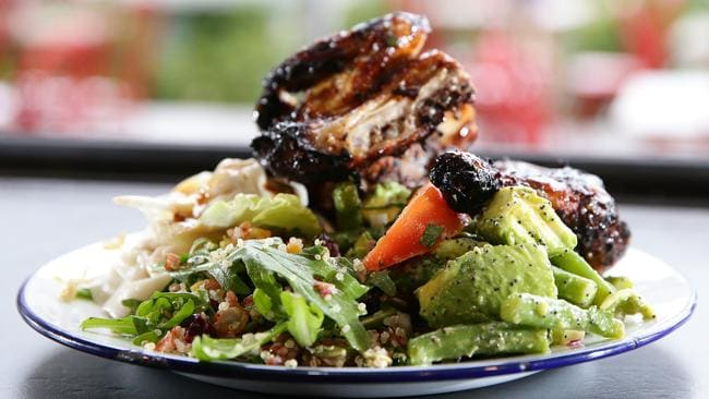 Healthy food, like this chicken salad with avocado vinaigrette, red rice and quinoa from Chargrill Charlies in Mona Vale, doesn't have to be boring or unappetising.