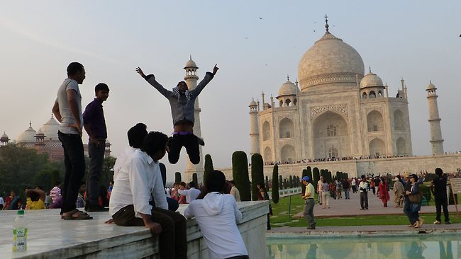 Young locals take pictures of each other outside the Taj Mahal. Picture: Angela Saurine
