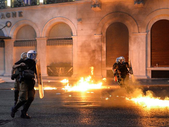 Riot police launch tear gas during the clashes.