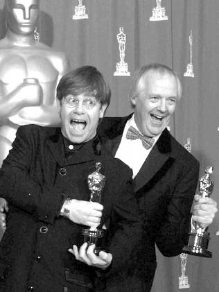 Elton John and Tim Rice backstage at the 67th annual Academy Awards.
