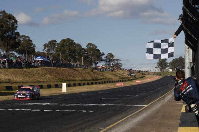 Whincup crossing the line to seal his 106th race win.