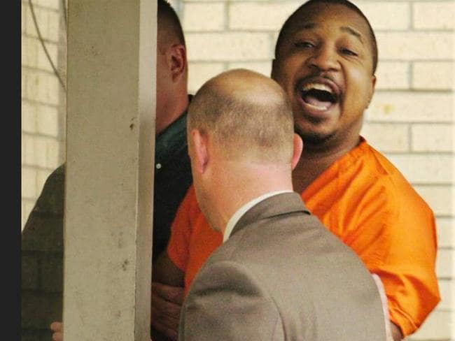 Lee is escorted from the courtroom after being sentenced to death