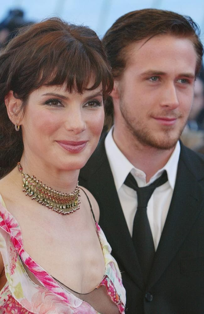 """Ryan Gosling and Sandra Bullock Sandra Bullock, 47, had a May-December romance with Ryan Gosling, 30, in 2001. Her good friend Hugh Grant would poke fun of the age difference by referring to her much younger boyfriend as """"the child."""" Picture: Getty Images"""