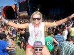 Adam Lyons gives Mieke Hyland a better view at the 2013 Adelaide Big Day Out music festival at Wayville Showgrounds.