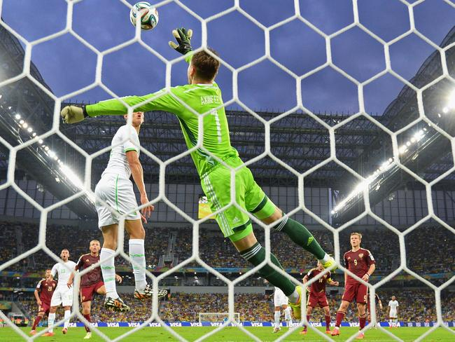 Igor Akinfeev making a save against Algeria, earlier in the match.