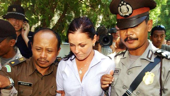 **FILE** An April 28, 2005 file photo of Australian Schapelle Corby being led to the holding cells at the Denpasar District Court for her sentencing submissions by her defence team. Corby is due to be deported to Australia from Indonesia on Sunday, May 28, 2017, after serving a prison sentence for importing marijuana. (AAP Image/Mick Tsikas) NO ARCHIVING