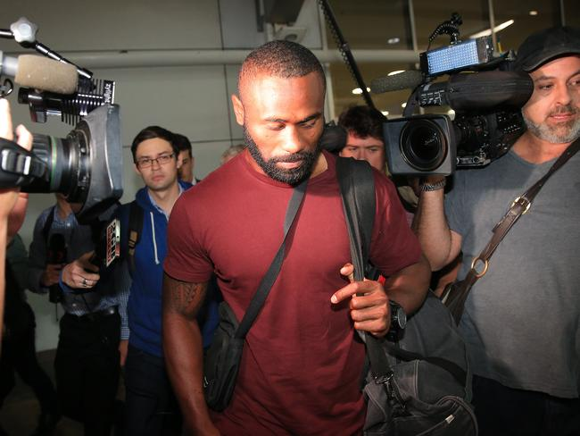 Semi Radradra wades through the media scrum at Sydney Airport yesterday. Picture: Mark Evans