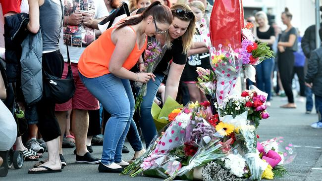 Mourners lay flowers at a candlelight vigil at the crash scene where Sarah died. Picture: Jay Town