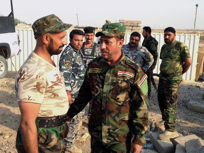 "Visit ... Iraqi lawmaker Hakim al-Zamili, centre, visits fighters of ""Peace Brigades"" on the outskirts of Samarra, north of Baghdad."