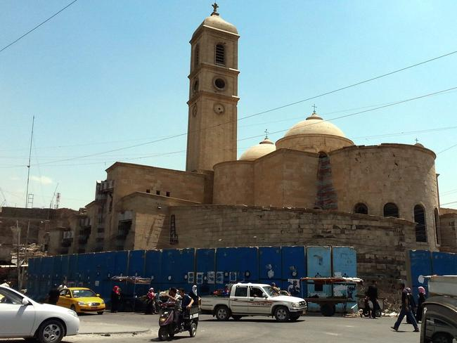 Under threat ... the Latin Catholic Church in Mosul, Iraq's second biggest city. Fighters from the Islamic State caliphate (IS) who recently demanded all Christians either pay tax, convert, leave or die causing a mass exodus of chrstians from the city.