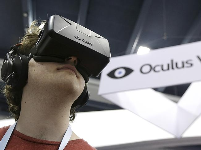 Peter Mason tries the Oculus virtual reality headset at the Game Developers Conference 2014.