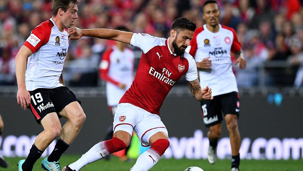 Olivier Giroud is well marshalled by the Wanderers defence.