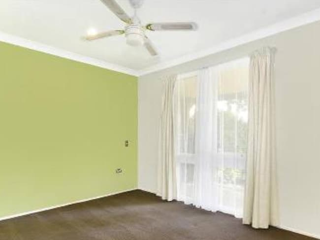 The ceiling fans were circulating in all the rooms including the back bedroom where police found the bodies of an adult woman and an 11-year-old girl. Picture: News Corp.