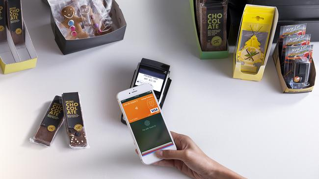 An ING Direct customer using Apple Pay on their smartphone to pay for goods. Picture: Supplied.
