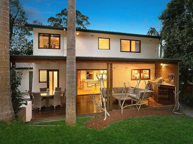 The rear of the house 1 Redgum Pl, Frenchs Forest which is on 917sqm of land.